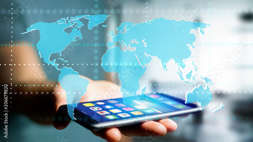 Businessman using a smartphone with a Connected world map - 3d render