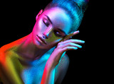 Fashion model woman in colorful bright sparkles and neon lights posing in studio, portrait of beautiful sexy girl. Art design colorful vivid makeup - 206691467