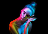 Fashion model woman in colorful bright sparkles and neon lights posing in studio, portrait of beautiful sexy girl. Art design colorful vivid makeup - 206691885