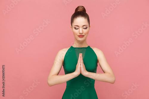 Spiritual practice. Woman closed eyes, doing meditation, mudram peace