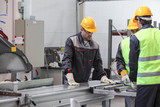 Workers at CNC machine shop - 206695891