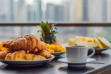 Breakfast table with coffee fruit and bread croisant on a balcony against the backdrop of the big city - 206703611