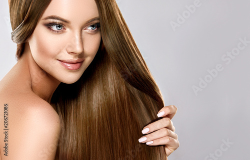 Fotobehang Kapsalon Beautiful brunette girl with long straight smooth hair . A woman with healthy straight hairstyle