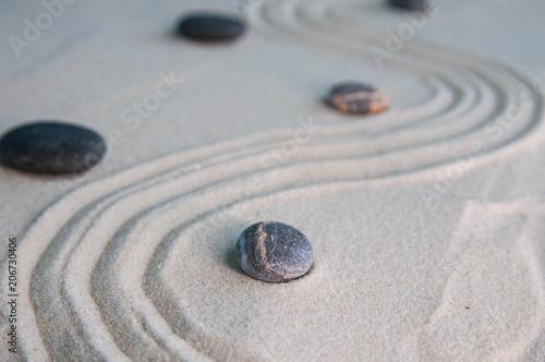 Aluminium Zen Stenen Pyramids of gray zen stones on light sand. Concept of harmony, balance and meditation, spa, massage, relax