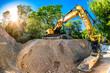 Big excavator in construction site