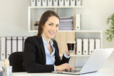 Office worker holding a coffee cup looking at camera - 206755044