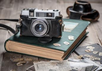 Vintage fotos, album and camera.