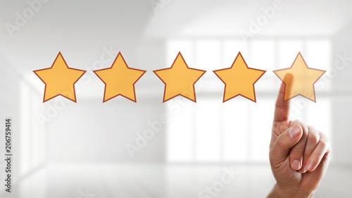 Leinwanddruck Bild Finger wählt 5 Sterne auf Touchscreen aus