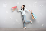 Almost flying. Emotional young woman smiling and pretending to fly while feeling happy after going shopping - 206777619