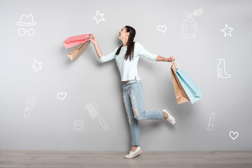 Almost flying. Emotional young woman smiling and pretending to fly while feeling happy after going shopping