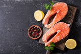 fresh salmon steaks with ingredients for cooking - 206787477