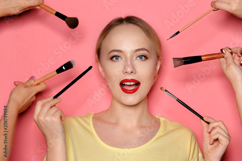 Leinwanddruck Bild Beauty portrait of a smiling beautiful half naked woman posing with make-up brushes
