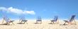 Leinwanddruck Bild - Viele Strandstühle auf Sand am Strand