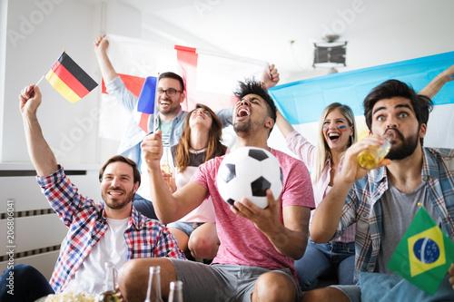 Foto Murales Group of multi-ethnic people celebrating football game