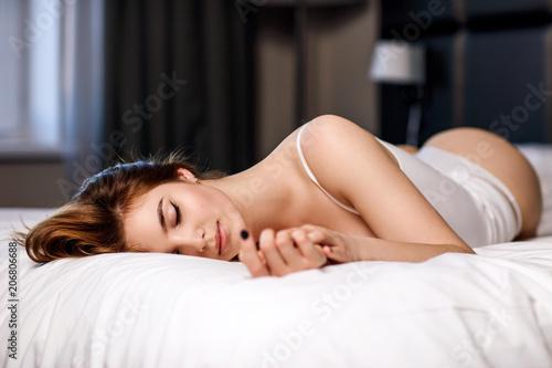 Leinwanddruck Bild Sexy brunette girl posing in lingerie in the room interior.