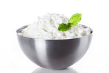 Fresh cottage cheese in a metal bowl isolated on white background. Close up - 206823016