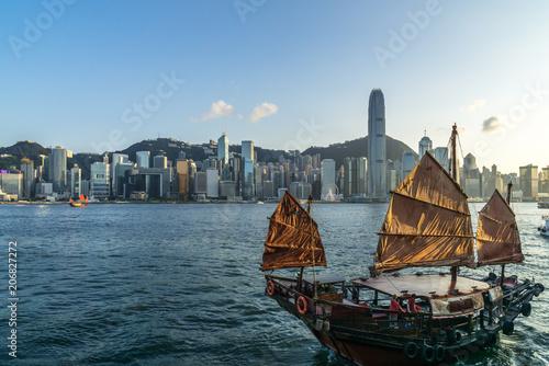 Fotobehang Zeilen sailboat with city skyline in hongkong china