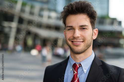 Poster Smiling young businessman
