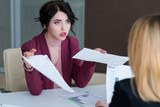 boss reproaching her employee. business woman getting a reprimand from chief manager. superior and subordinate professional relationship. - 206835800