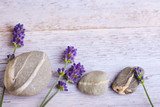 Lavender flowers and stones on rustic wooden background - 206837470