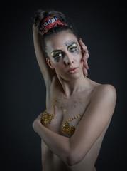 woman with Egyptian make-up on dark background © Vincenzo De Bernardo