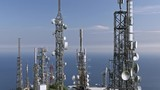 aerial view of telecom antennas telecommunications towers on mountaintop - 206842850