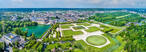 Aerial view of Chateau de Fontainebleau with its gardens, a UNESCO World Heritage Site in France - 206844613
