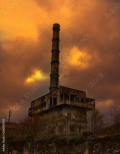 Fotobehang Gebouw in Puin Abandoned factory in mountains.