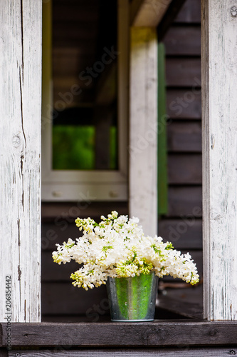Bouquet of blooming white lilac on the terrace