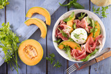 melon, mozzarella and prosciutto ham salad - 206856819