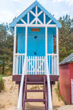 Wells-next-the-Sea, Norfolk, UK: May 2018. Pastel blue colored beach cabin wooden hut - 206860261