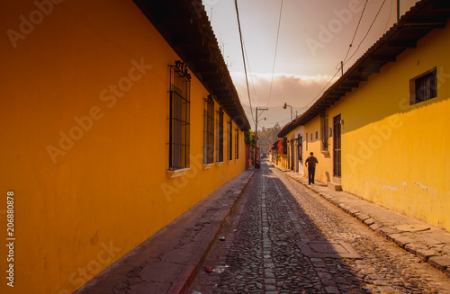 Outdoor view of stoned street with some old building houses and the historic city Antigua is UNESCO World Heritage Site since 1979