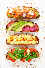 Assortment of healthy and colorful brunch toasts