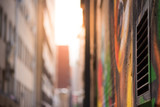 Abstract style photograph looking down a graffiti lined alley way towards the sun. Johannesburg inner city