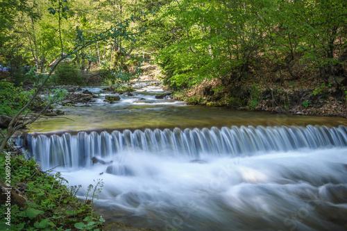 Fotobehang Bergrivier Cascades on a mountain river