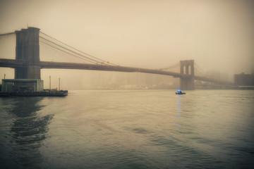 Brooklyn bridge at foggy rainy evening, New York City