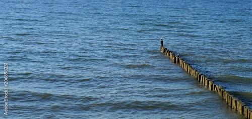 Fotobehang Noordzee Wellenbrecher Srand und Meer