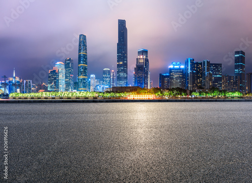 Fotobehang Purper empty asphalt square road and modern city skyline in Guangzhou at night,China