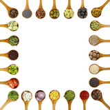 spices in wooden spoons isolated - 206923487