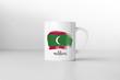 Maldives flag souvenir mug on white background. 3D rendering.