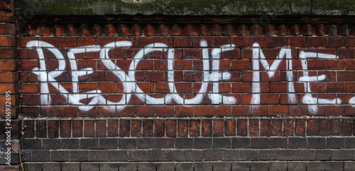 Fotobehang Graffiti Rescue me graffiti on a brick wall