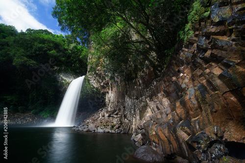 Huge waterfall at Bassin la paix in Reunion Island
