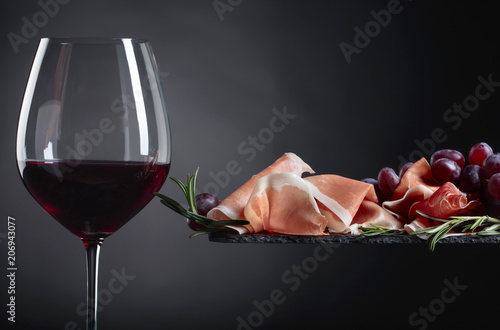 Prosciutto with rosemary and glass of red wine. - 206943077