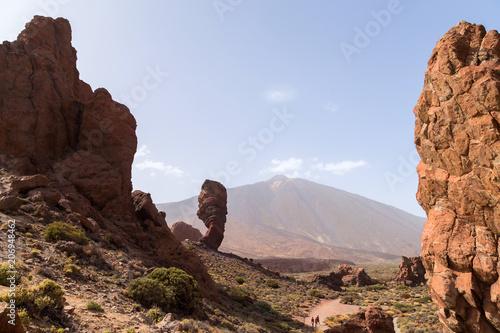 Fotobehang Chocoladebruin Teide National Park. Volcanic mountain scenery. Pico del Teide. View of Teide volcano peak and Teleferico Del Teide cable road. Tenerife, Canary Islands, Spain
