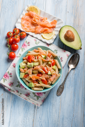 Foto Murales cold pasta with smoked salmo avocados and tomatoes