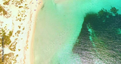 Aerial view of amazing, unspoiled and idyllic beach on a little island