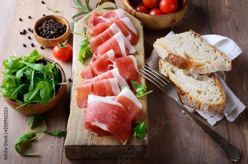 Tray with raw ham, italian prosciutto crudo