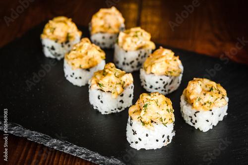 Aluminium Sushi bar dishes of Japanese cuisine rolls with fish