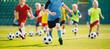 Leinwandbild Motiv Football soccer training for kids. Children football training session. Kids running and kicking soccer balls. Young boys improving soccer skills
