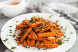 Baby carrots roasted with parmesan and herbs - 206973457